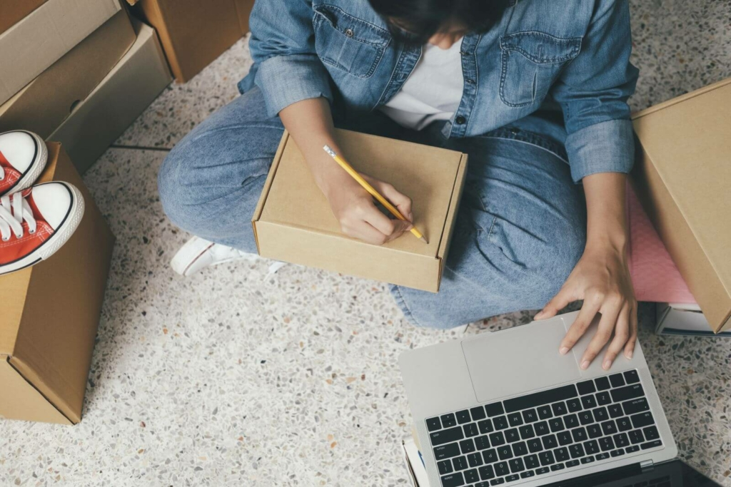 Online Small Business Owner Writing Address On Par